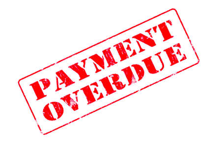 Rubber stamp concept showing a red stamp reading Payment Overdue Stock Photo