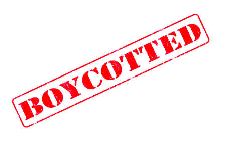 Rubber stamp concept showing a red stamp reading Boycotted Stock Photo