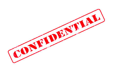 Rubber stamp concept showing a red stamp reading Confidential