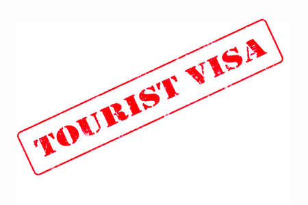 Rubber stamp concept showing a red stamp reading Tourist Visa Stock fotó