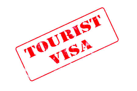 Rubber stamp concept showing a red stamp reading Tourist Visa