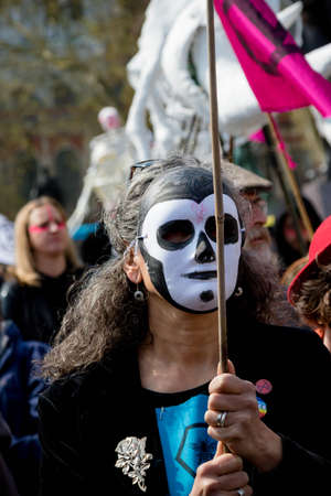 London, United Kingdom, 15th April 2019:- Extinction Rebellion protesters in Parliament Square, hold a funeral for biodiversity loss due to climate change