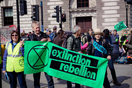London, United Kingdom, 15th April 2019:- Extinction Rebellion protesters in Parliament Square, protesting about climate change.