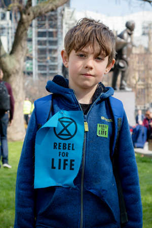 London, United Kingdom, 15th April 2019:- Extinction Rebellion child protester in Parliament Square, protesting about climate change.