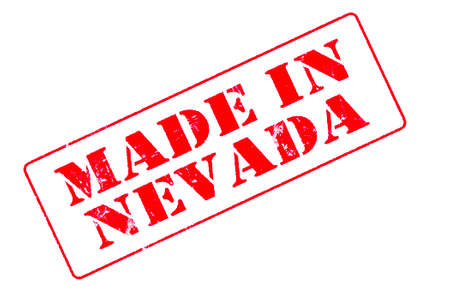 Rubber stamp concept showing a red stamp reading Made in Nevada Stock Photo