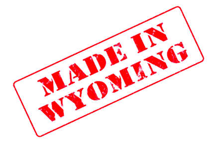Rubber stamp concept showing a red stamp reading Made in Wyoming Stock Photo