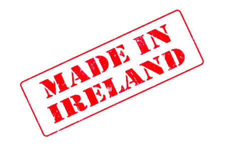 Rubber stamp with red ink on white background concept reading Made In Ireland