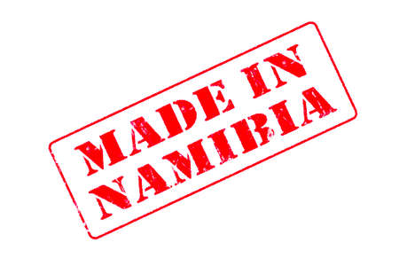 Rubber stamp with red ink on white background concept reading Made In Namibia 版權商用圖片