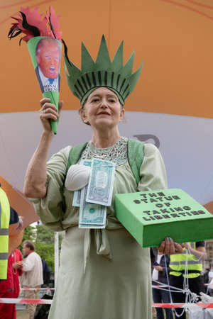 London, United Kingdom, June 4th 2019:- Auriel Glanville, member of Friends of The Earth protesting against Climate Change infront of the Trump Baby Blimp Editorial