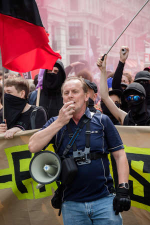 London, United Kingdom, August 3rd 2019:- A protester with a megaphone counter protesting a rally by supporters of former EDL leader Tommy Robinson
