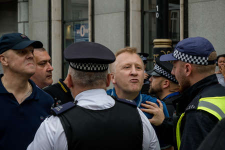 London, United Kingdom, August 3rd 2019:- Police intervene prevent Tommy Robinson supporters and anti facist demonstrators clashing