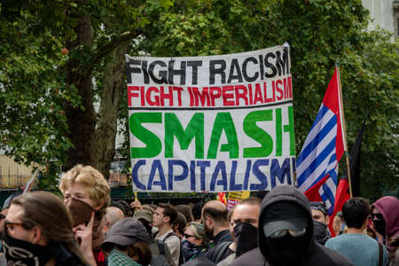 London, United Kingdom, August 3rd 2019:- Anti fascist demonstrators march in opposition to a rally by supporters of the former EDL leader Tommy Robinson Banco de Imagens - 131958670