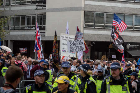 London, United Kingdom, August 3rd 2019:- Police forming a line to control an anti fascist demonstration in opposition to a rally by supporters of the former EDL leader Tommy Robinson