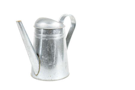 A metal watering can isolated on a white background Banco de Imagens