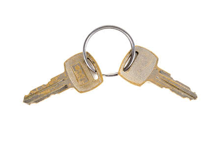 A pair of keys on a white background Stock Photo
