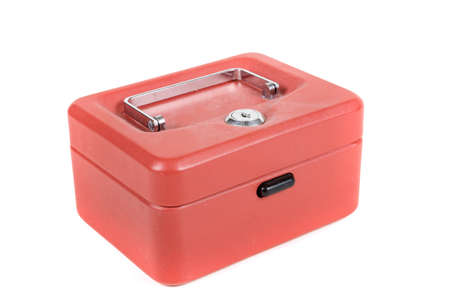 A red metal money box on a white background