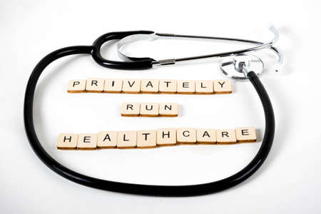 Medical or Healthcare concept with a stethoscope and the message Privately Run Healthcare Stock Photo