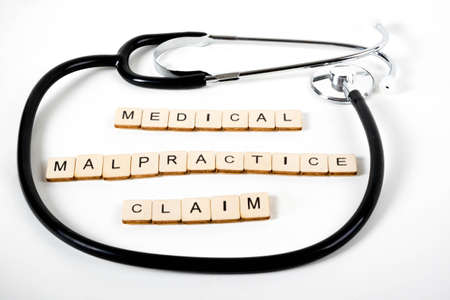 Medical or Healthcare concept with a stethoscope and the message Medical Malpractice Claim Stock Photo
