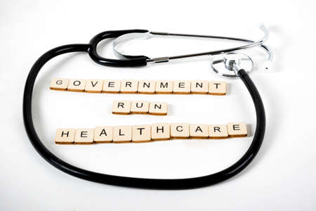 Medical or Healthcare concept with a stethoscope and the message Government Run Healthcare Stock Photo