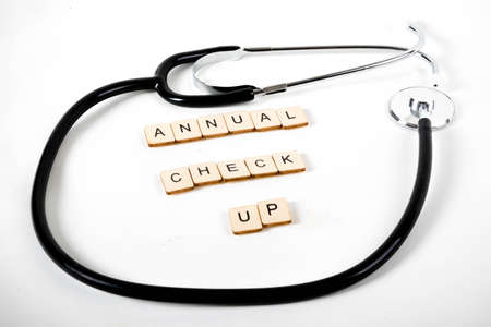 Medical or Healthcare concept with a stethoscope and the message Annual Check Up