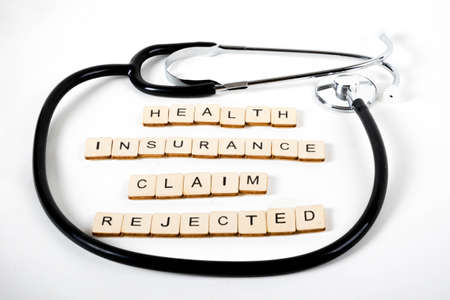 Medical or Healthcare concept with a stethoscope and the message Health Insurance Claim Rejected