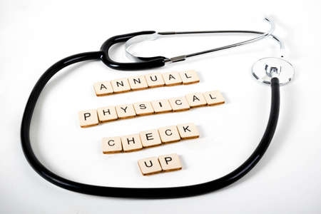 Medical or Healthcare concept with a stethoscope and the message Annual Physical Check Up Banco de Imagens