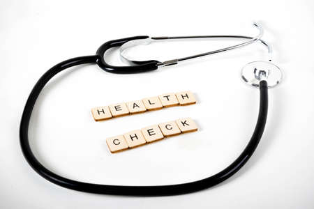 Medical or Healthcare concept with a stethoscope and the message Health Check Banco de Imagens