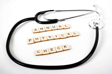 Medical or Healthcare concept with a stethoscope and the message Annual Physical Check