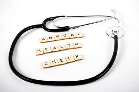 Medical or Healthcare concept with a stethoscope and the message Annual Health Check
