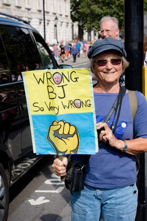 London, United Kingdom, August 31st 2019:- Protesters in Whitehall, Central London protesting Prime Minister Boris Johnsons plan to suspend Parliament for five weeks with insulting signs about sex acts