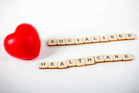 Healthcare concept showing a heart and the message socialised healthcare Stock Photo