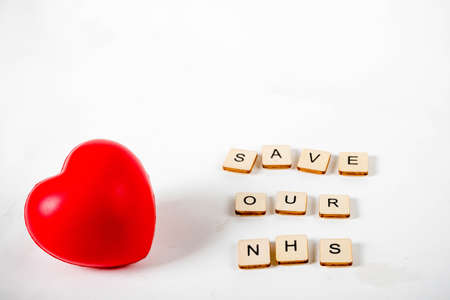 Healthcare concept showing a heart and the message save our NHS