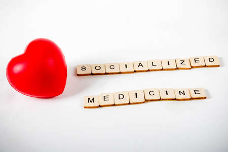 Healthcare concept showing a heart and the message socialized medicine Stock Photo