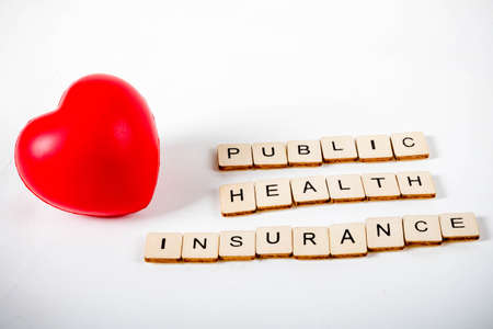 Healthcare concept showing a heart and the message public health insurance