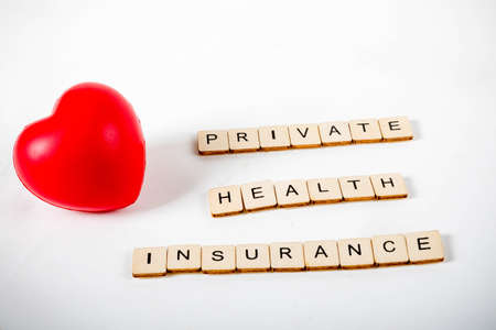 Healthcare concept showing a heart and the message private health insurance