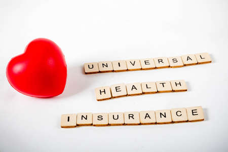 Healthcare concept showing a heart and the message universal health insurance
