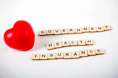 Healthcare concept showing a heart and the message government health insurance