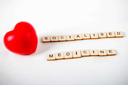 Healthcare concept showing a heart and the message socialised medicine