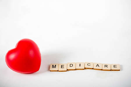 Healthcare concept showing a heart and the message medicare 写真素材 - 129886780