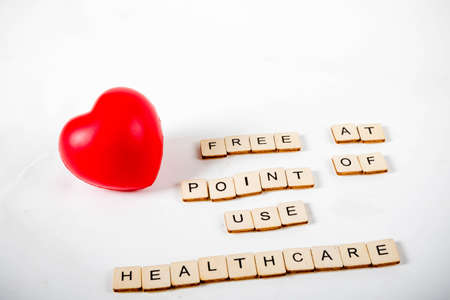 Healthcare concept showing a heart and the message free at point of use healthcare Stock fotó