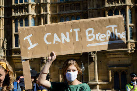 London, United Kingdom, 20th September 2019:- Climate Change Protesters gather in Westminster, central London near the British Parliament as part of a global day of protest Reklamní fotografie - 132337766