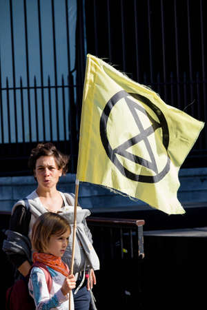 London, United Kingdom, 20th September 2019:- Climate Change Protesters gather in Westminster, fly the flag of Extinction Rebellion Reklamní fotografie - 132337768