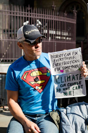 London, United Kingdom, 20th September 2019:- Climate Change Protesters gather in Westminster, central London near the British Parliament as part of a global day of protest Reklamní fotografie - 132337775