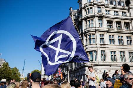 London, United Kingdom, 20th September 2019:- Climate Change Protesters gather in Westminster, fly the flag of Extinction Rebellion Redakční