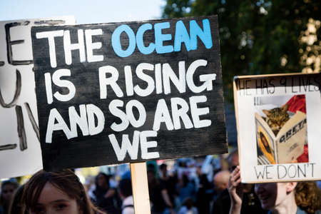 London, United Kingdom, 20th September 2019:- Climate Change Protesters gather in Westminster, central London near the British Parliament as part of a global day of protest Reklamní fotografie - 132419011