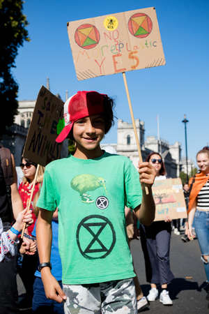 London, United Kingdom, 20th September 2019:- Climate Change Protesters gather in Westminster, central London near the British Parliament as part of a global day of protest Reklamní fotografie - 132419013