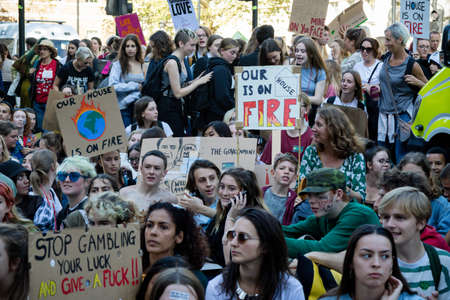 London, United Kingdom, 20th September 2019:- Climate Change Protesters sit in Westminster, central London outside Downing Street
