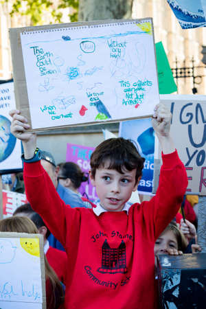 London, United Kingdom, 20th September 2019:- Climate Change Protesters gather in Westminster, central London near the British Parliament as part of a global day of protest Reklamní fotografie - 132419019