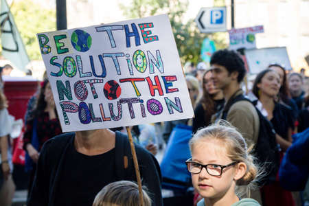 London, United Kingdom, 20th September 2019:- Climate Change Protesters gather in Westminster, central London near the British Parliament as part of a global day of protest Reklamní fotografie - 132419021