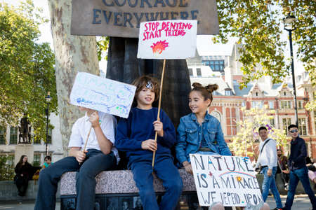 London, United Kingdom, 20th September 2019:- Climate Change Protesters gather in Westminster, central London near the British Parliament as part of a global day of protest Reklamní fotografie - 132419027